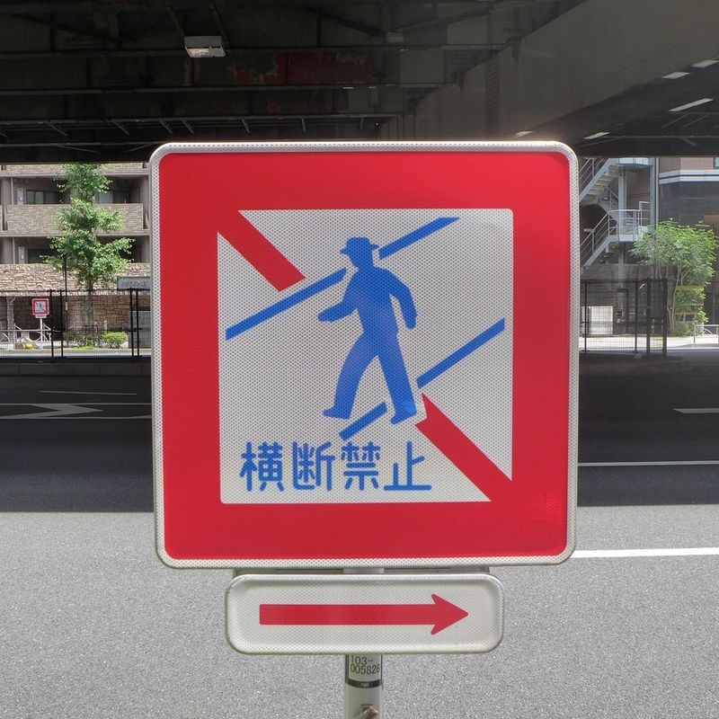 Man crossing sign