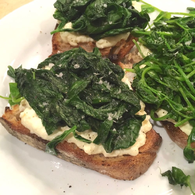 Crostini with fava leaves and pea shoots