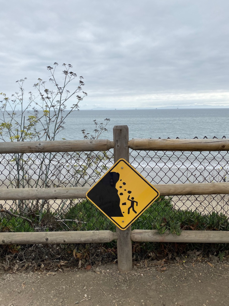 Summerland beach cliff warning sign