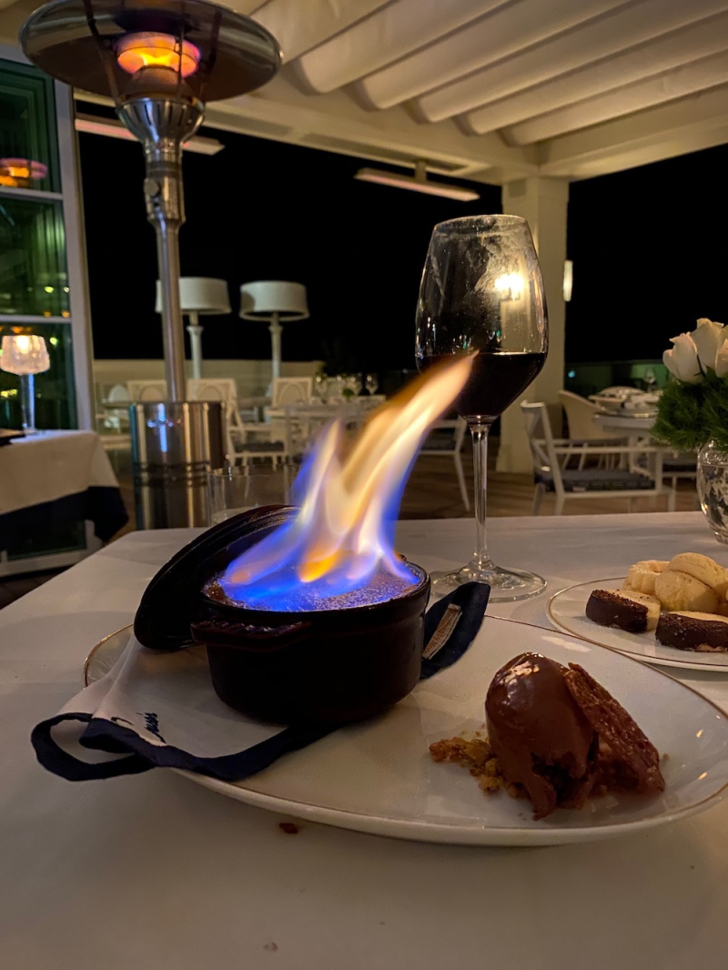 Flaming creme brulee at Carusos Rosewood Miramar